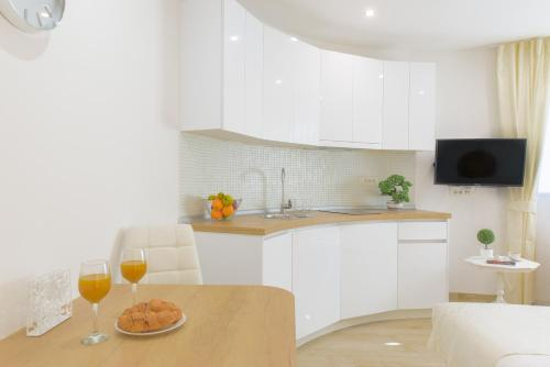 A kitchen or kitchenette at Best location Apartments