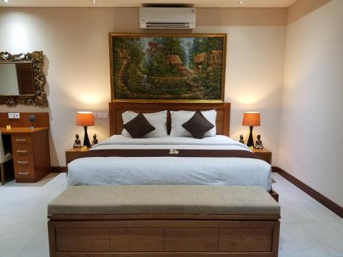 A bed or beds in a room at The Oasis Retreat Seminyak