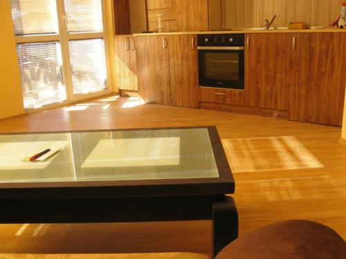 A television and/or entertainment center at Apartments Borovets