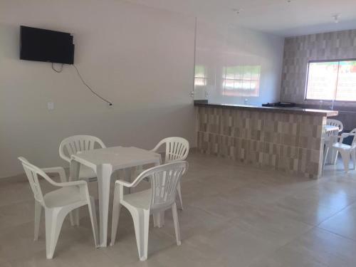 Una televisión o centro de entretenimiento en Casa Afonso Pena