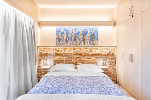 A bed or beds in a room at Acropolis Suites - Where else in Athens?
