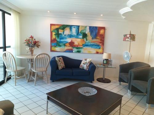 A seating area at Apartamento em Boa Viagem