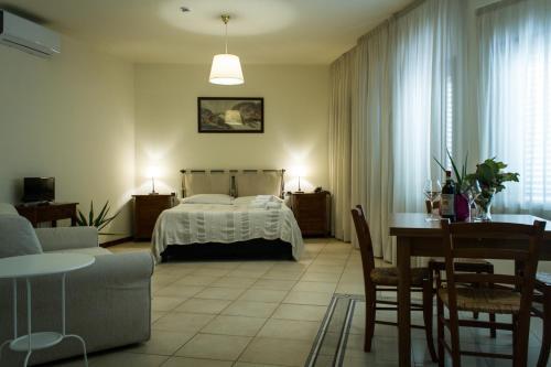 Letto o letti in una camera di Residence Montefiore