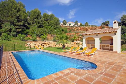 The swimming pool at or near Villa Cortez