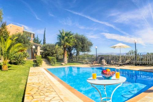 The swimming pool at or near Villa Malama