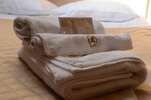 A bed or beds in a room at Zajazd Bieszczadzka Ostoja
