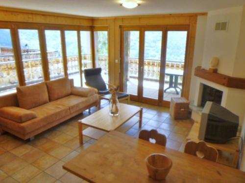 Ein Sitzbereich in der Unterkunft Résidence Balcons du Soleil