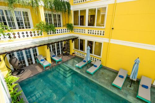 A view of the pool at TRIPLE Riverside Villa HoiAn or nearby