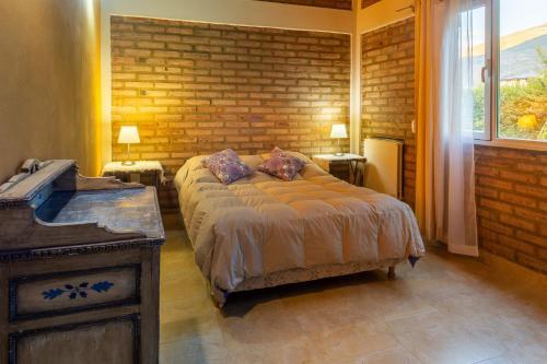 Una cama o camas en una habitación de Casa Aigua