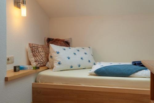 Ein Bett oder Betten in einem Zimmer der Unterkunft Ferienhotel Sonnenheim