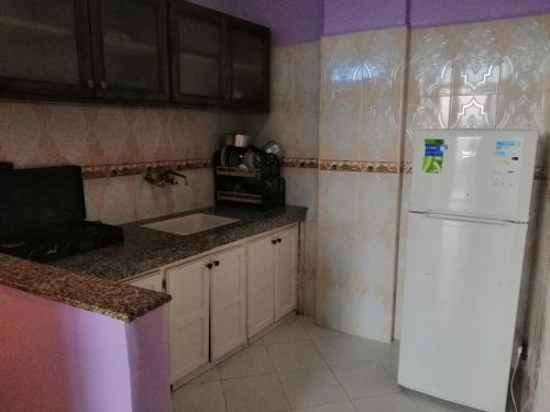 A kitchen or kitchenette at Taghazout Holidays