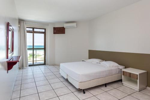 A bed or beds in a room at Residencial Porto Príncipe