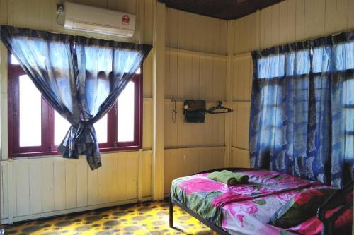 Katil atau katil-katil dalam bilik di Bonda Homestay