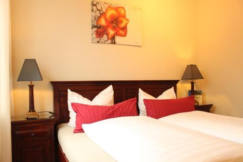 Ein Bett oder Betten in einem Zimmer der Unterkunft Sommer & Jaeger Ferienwohnung