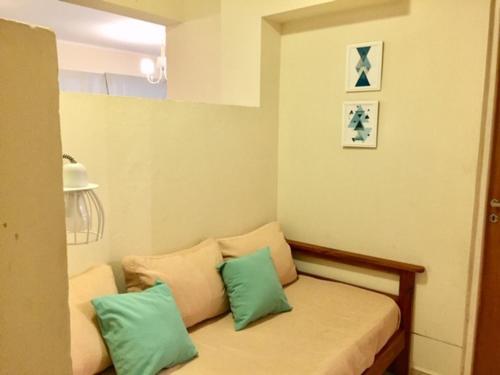Una cama o camas en una habitación de Departamento frente al mar Espectacular