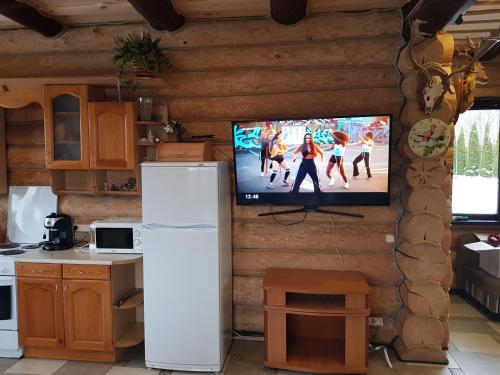 Телевизор и/или развлекательный центр в Usadba na Narochi