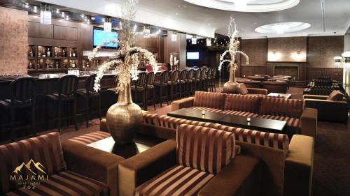 Lounge alebo bar v ubytovaní Apartman Majami 703 - Hotel Residence Donovaly