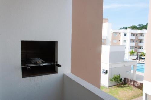 Una televisión o centro de entretenimiento en Residencial Porto Caravelas