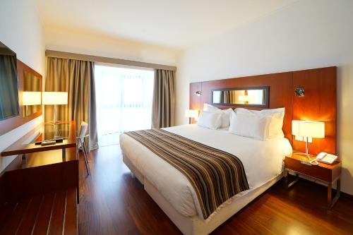 Łóżko lub łóżka w pokoju w obiekcie Legendary Lisboa Suites