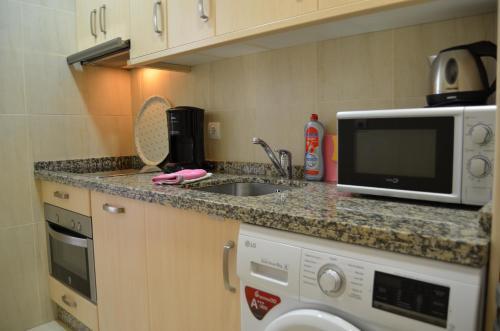 Кухня или мини-кухня в Carabeo Vista Mar