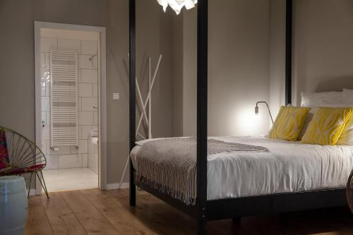 A bed or beds in a room at The Suite Hotel Fabric