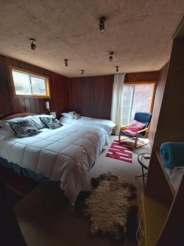 Cama o camas de una habitación en Hostal Entre Volcanes
