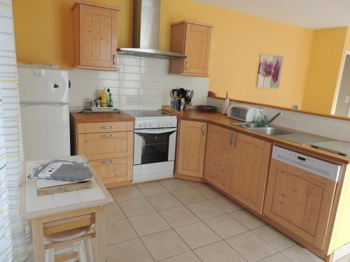 A kitchen or kitchenette at BRUYERE D'ANDAINE