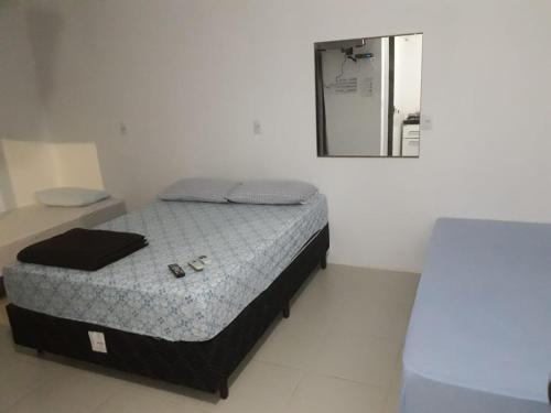 Cama ou camas em um quarto em Pouse Bem
