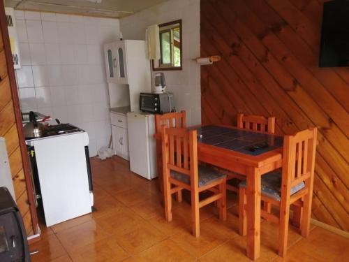 Una cocina o zona de cocina en Cabanas Covadonga