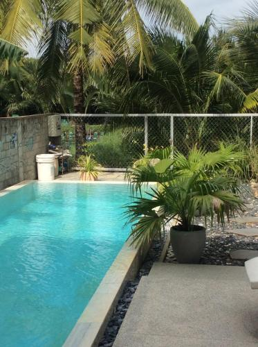 The swimming pool at or near Nha Maica