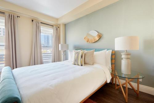 A bed or beds in a room at Sonder — The Marin