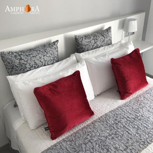 A bed or beds in a room at Amphora