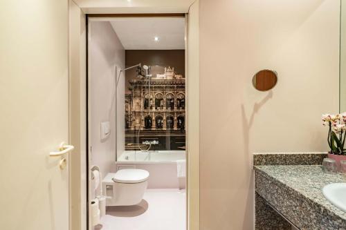 Ein Badezimmer in der Unterkunft Starlight Suiten Hotel Renngasse