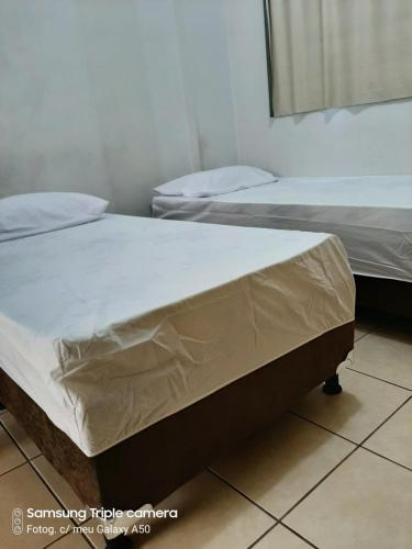 A bed or beds in a room at Flats Residence Bueno