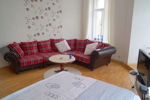 Ein Sitzbereich in der Unterkunft Ferienwohnung Schlossblick Altenburg (Frühstückspension möglich)