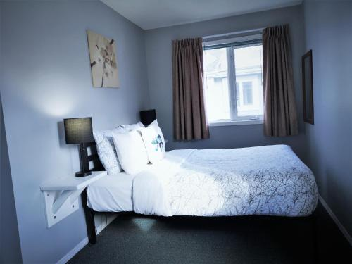 A bed or beds in a room at Canadian Rockies Chalets