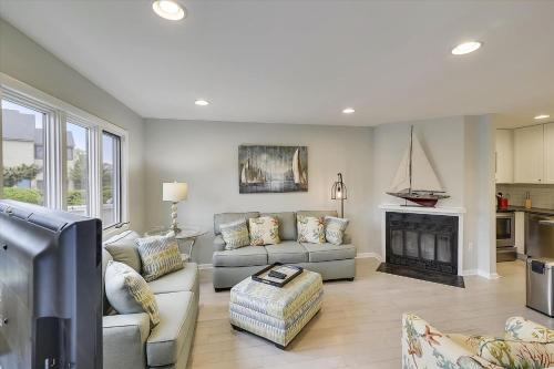 A seating area at Baystrand III Unit 9 by Long & Foster