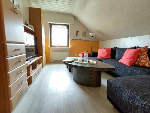 Ein Sitzbereich in der Unterkunft Die Ferienwohnung Lindenhof