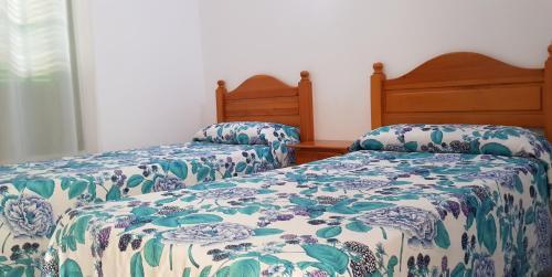 Cama o camas de una habitación en Apartamentos Europa