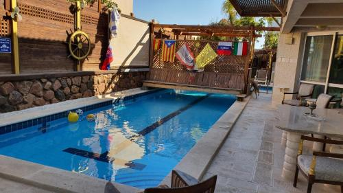 The swimming pool at or near Thai Villa Eilat