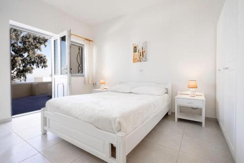 A bed or beds in a room at Ersi Villas