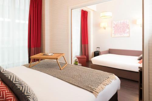 Cama o camas de una habitación en Aparthotel Adagio Brussels Grand Place