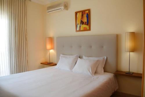 Postel nebo postele na pokoji v ubytování Flamingo