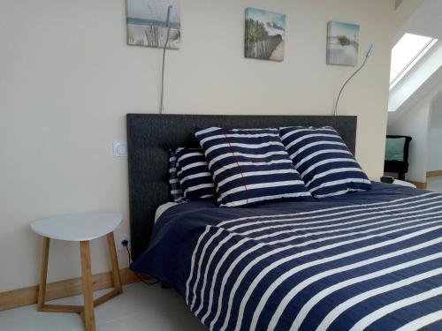 Un ou plusieurs lits dans un hébergement de l'établissement Kerautret Vian