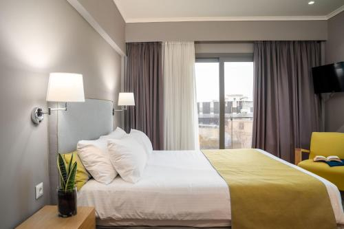 A bed or beds in a room at CHROMA FASHION ROOMS & APARTMENTS