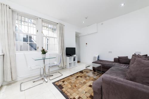 Ein Sitzbereich in der Unterkunft Small house in Marylebone@London