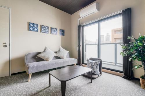 พื้นที่นั่งเล่นของ ALZA Fukushima AFP Apartment