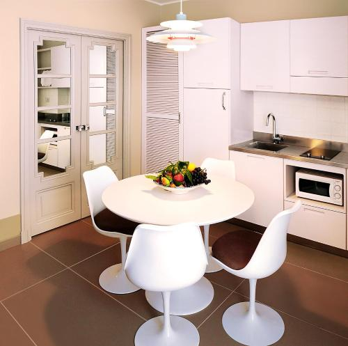 A kitchen or kitchenette at Cala del Porto Residence