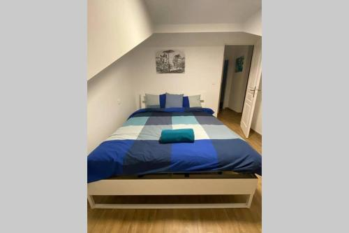 A bed or beds in a room at apartement city center mons