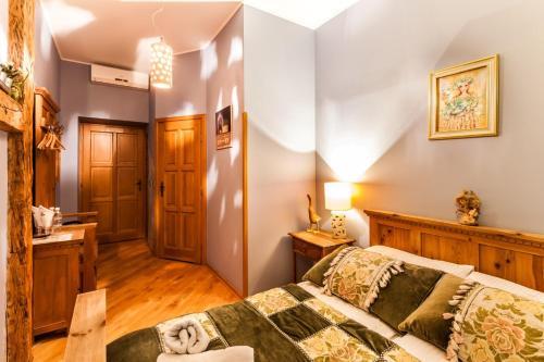 Łóżko lub łóżka w pokoju w obiekcie Aparthotel Oberża
